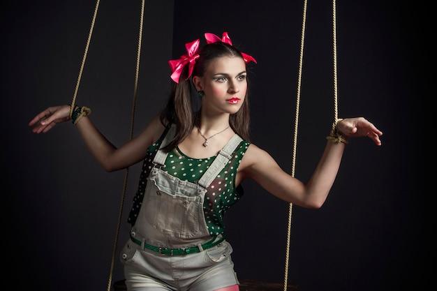 Woman puppet hands tied posing. fashion art Premium Photo
