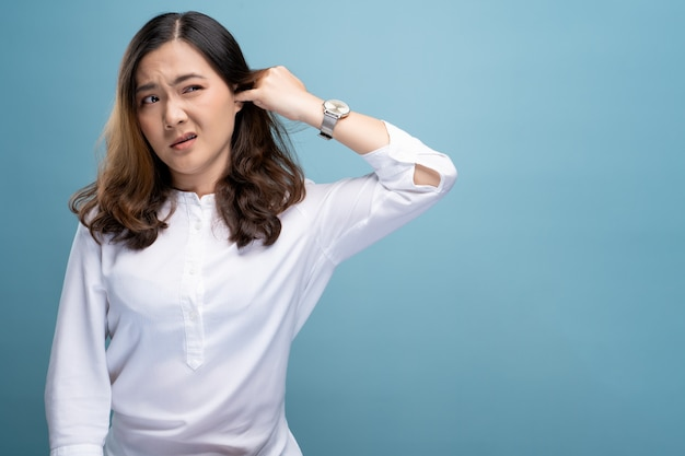 Woman putting a finger into her ear Premium Photo