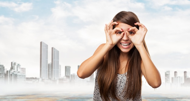 Woman putting on glasses with her hands Free Photo