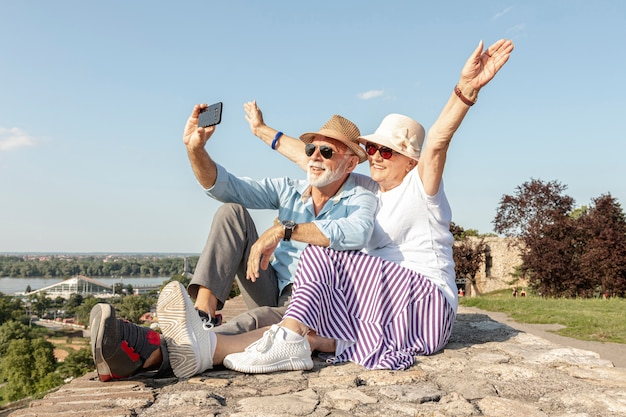 Woman raising her hands while taking a selfie Premium Photo
