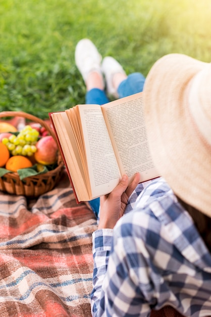 Woman reading book on picnic Free Photo
