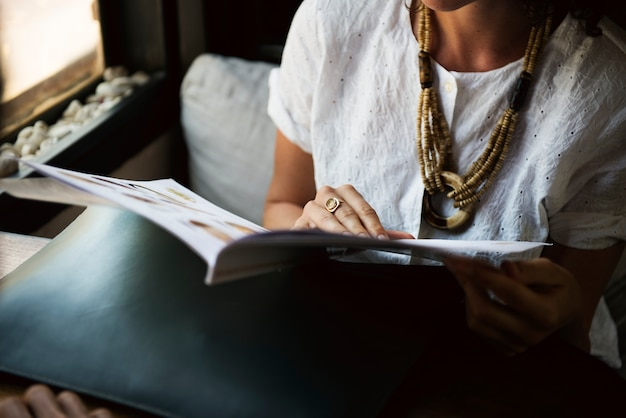 Woman reading magazine at coffee shop Free Photo