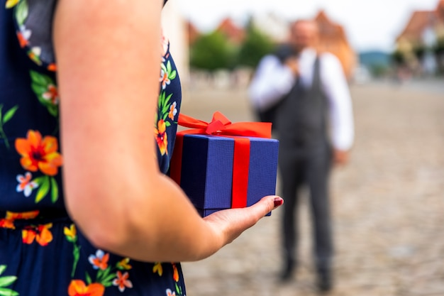 Woman ready to give a present Free Photo