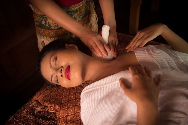 Woman receiving a massage on the clavicle Free Photo