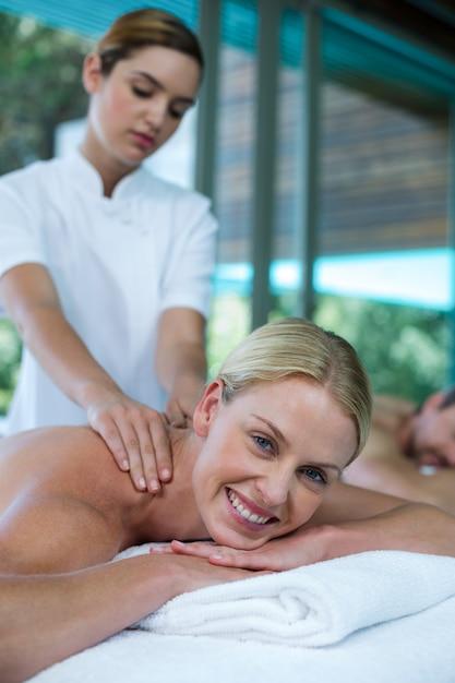 Woman receiving back massage from masseur Premium Photo