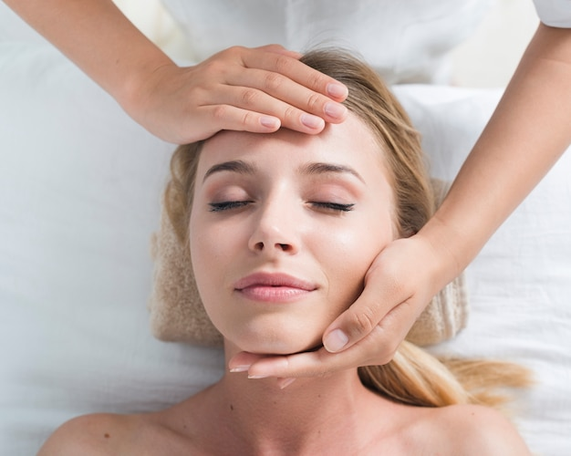 Woman receiving a facial massage in a spa Free Photo