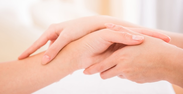 Woman receiving a hand massage at the health spa. Premium Photo