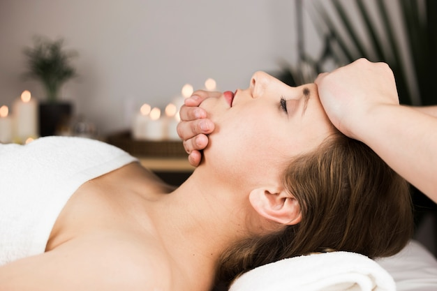 Woman receiving massage in spa center Free Photo