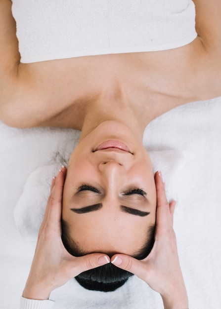 Woman Receiving A Relaxing Facial Massage Free Photo
