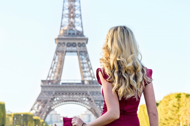 Woman in red dress at eiffel tower in france Premium Photo