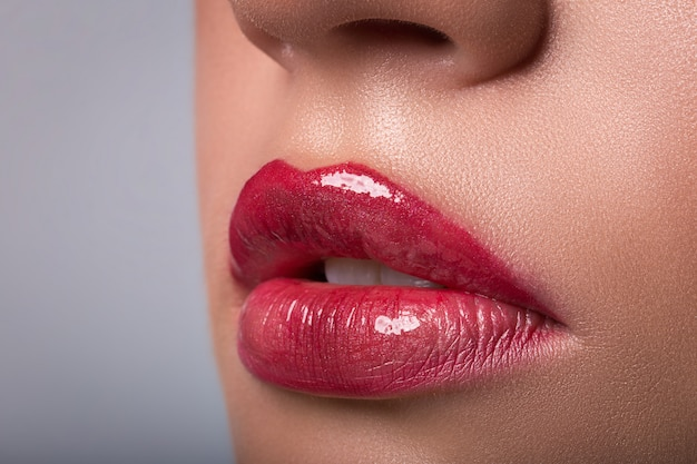 Woman red lips closeup Premium Photo