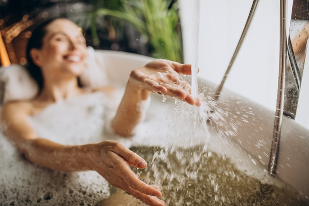 Woman relaxing in bath with bubbles Free Photo