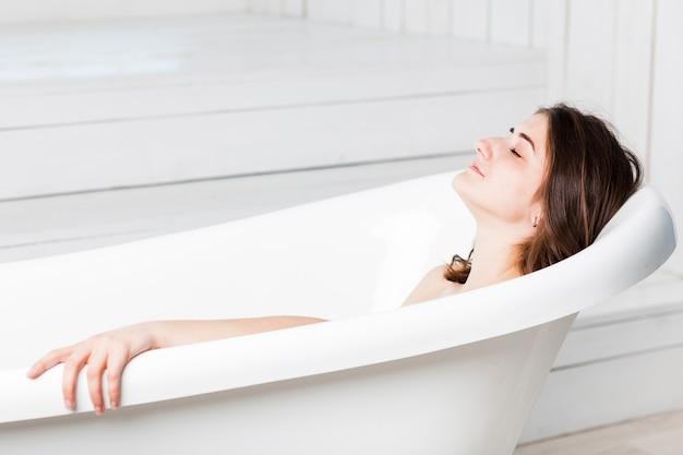 Woman relaxing in bathtub Free Photo