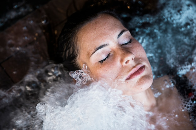 Woman relaxing in whirlpool Free Photo