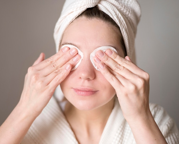 Woman removing eye shadow Free Photo