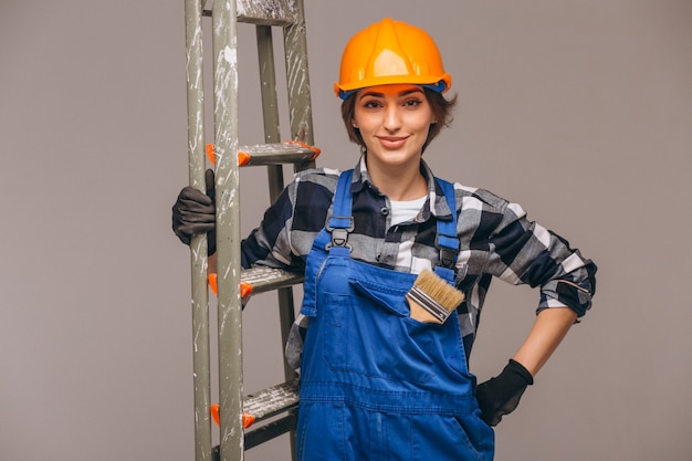 Woman repairer with ladder in a uniform isolated Free Photo