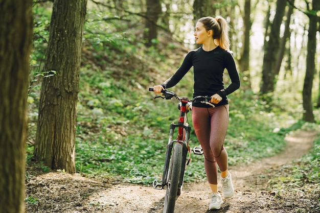 Woman riding a mountain bike in the forest Free Photo