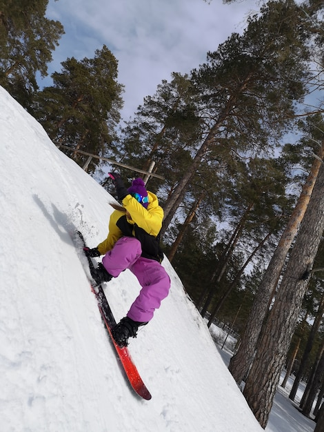 Woman Riding A Snowboard Winter Sports Girl In Gear On A