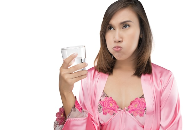Woman rinsing and gargling while using mouthwash Premium Photo