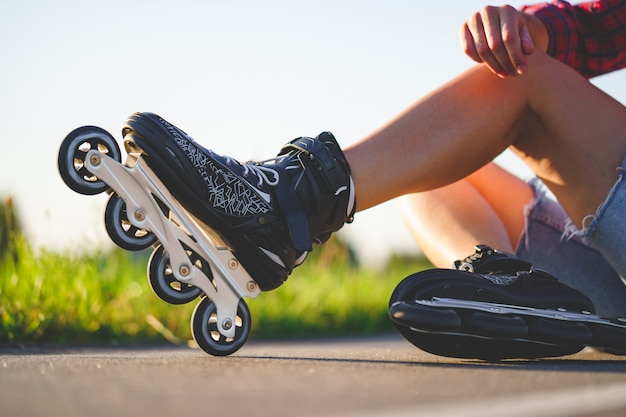 Woman in roller skates during inline skating outdoors. active lifestyle. teenager during rollerblading Premium Photo