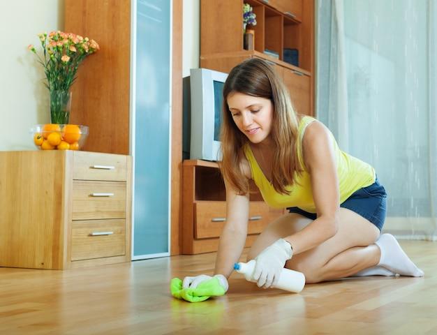 Woman rubbing wooden floor Free Photo