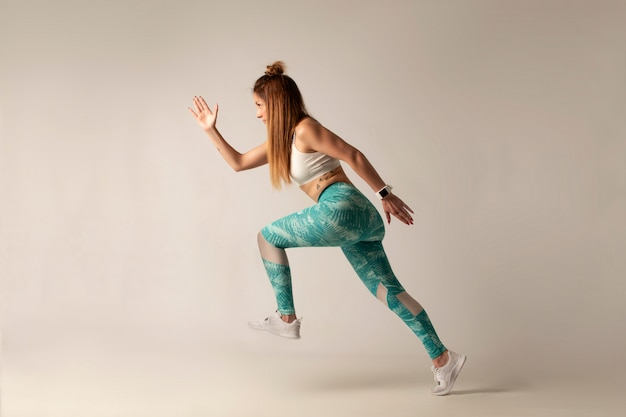 Woman runner in silhouette on white background Premium Photo