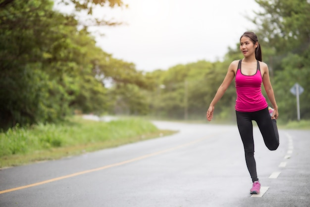 Woman runner warm up outdoor Premium Photo