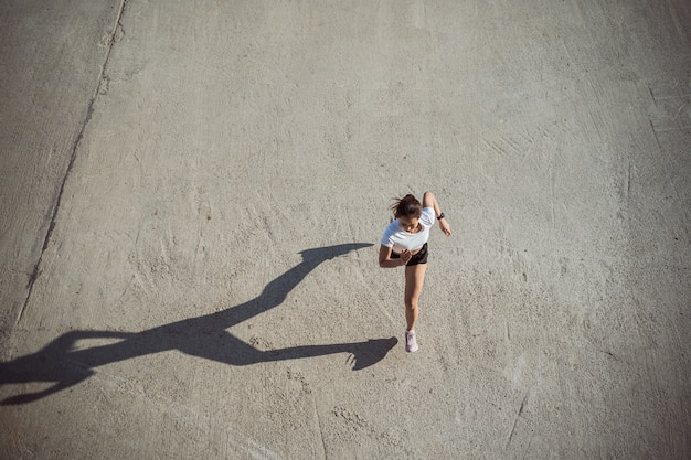 Woman runners morning exercise, top view image Free Photo