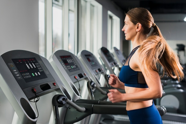 Woman running in gym Free Photo