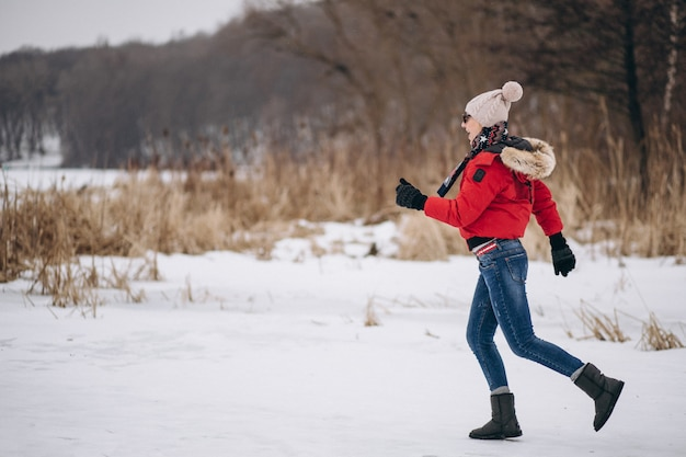 Woman running on lake in winter Free Photo