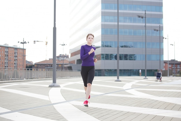 Woman running in milan - italy Premium Photo