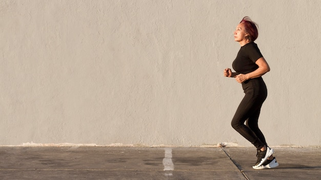 Woman running outdoors copy space Premium Photo