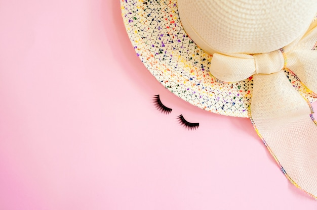 Woman's accessories flat lay on colorful background. top view. blue and yellow pastel colors with copy space around products. horizontal image or photograph. Premium Photo
