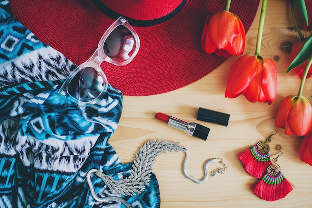 Woman's accessories and red tulips on table Free Photo