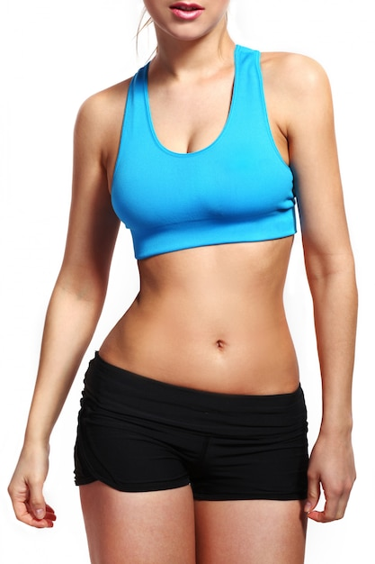 Woman's body in a fitness wear Free Photo