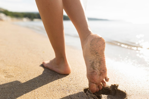 Woman's feet on beach sands Free Photo