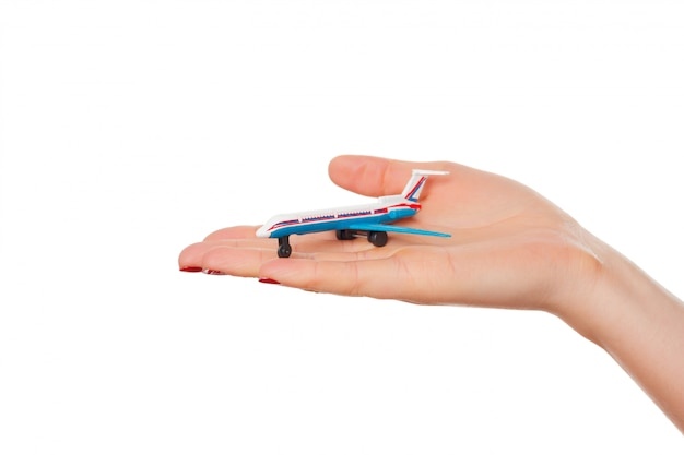 Woman's hand holding toy airplane isolated on white background Premium Photo