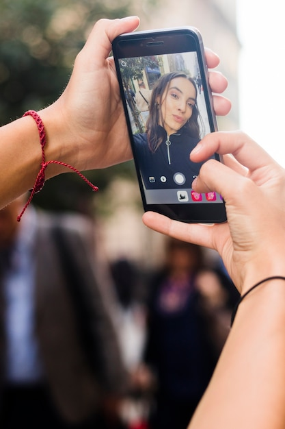 Woman's hand taking self portrait with smart phone Free Photo