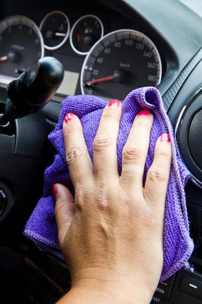 Woman's hand with microfiber cloth polishing  a car Premium Photo