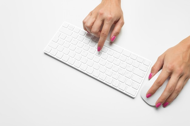 Woman's hands on a keyboard Premium Photo