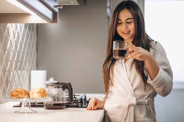 Woman's morning with coffee and croissant Free Photo
