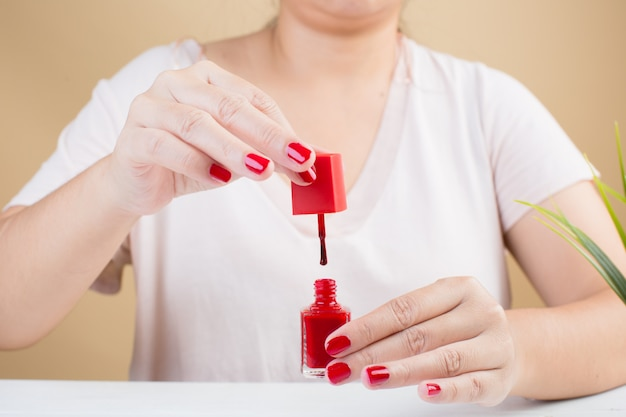 Woman's nails with red nail polish Free Photo