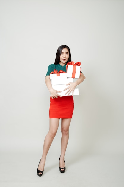 Woman in santa hat with many gifts Premium Photo