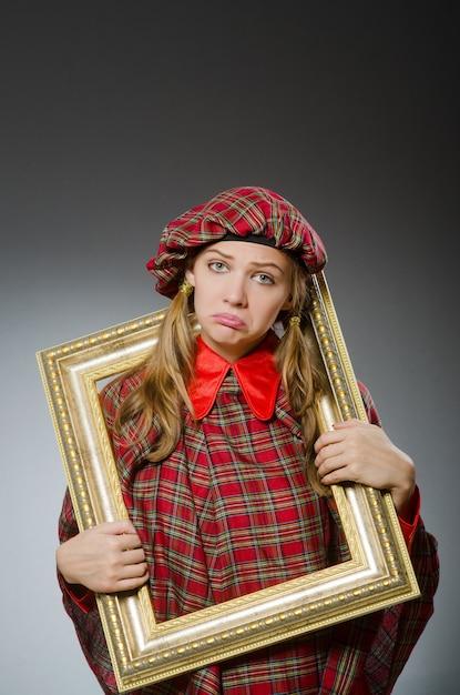 Woman in scottish clothing in art concept Premium Photo