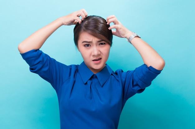 Woman scratching her head Premium Photo