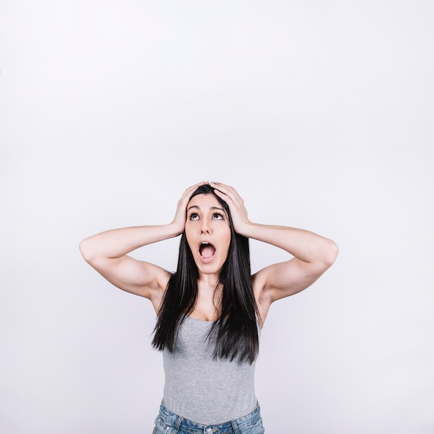 Woman screaming and looking up Free Photo