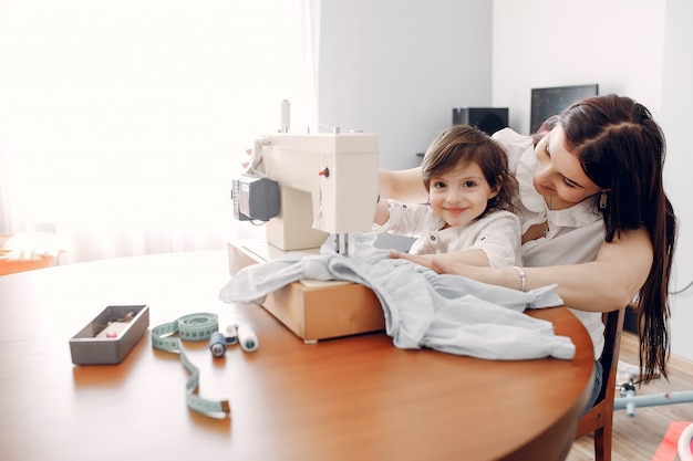 Woman sewing on a sewing machine Free Photo