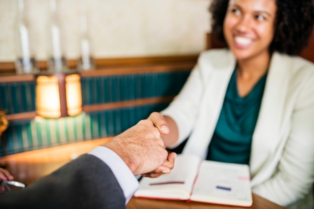Woman shaking hands with business partner Free Photo