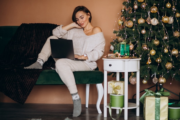 Woman shopping online on christmas sales Free Photo