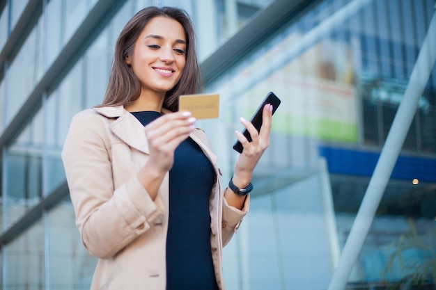 Woman shopping with credit card. Premium Photo